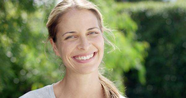 Close-up portrait of beautiful woman smiling outdoors slow motion Royalty-free stock video