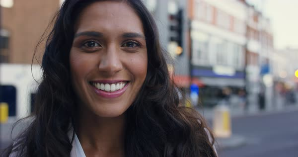 Smiling Portrait of Beautiful woman in the city Royalty-free stock video