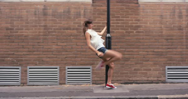 Woman freestyle dancing in the city Royalty-free stock video