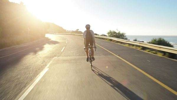 Healthy man cycling on road outdoors Royalty-free stock video