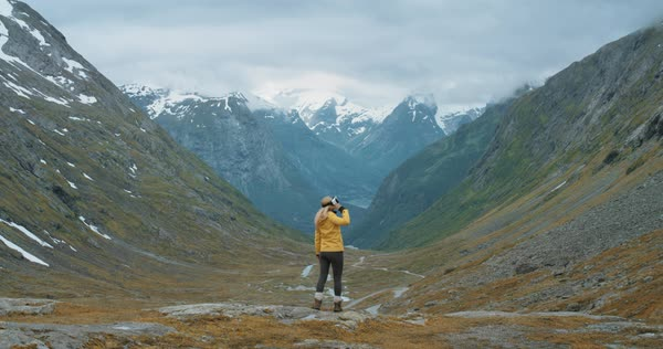 Woman traveler in Norway wearing virtual reality headset looking at mountain view enjoying outdoor travel experience  watching 360 video imagination concept Royalty-free stock video