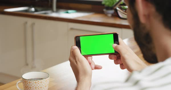 Close-up man holding smartphone green screen chroma-key green screen sharing social media Royalty-free stock video