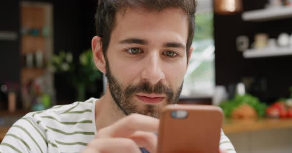 Close-up of man shopping online with credit card and smartphone at home in trendy loft apartment Royalty-free stock video