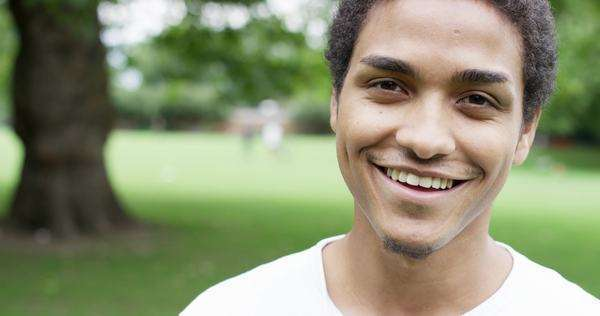 Close up portrait happy young mixed race man smiling at camera Royalty-free stock video
