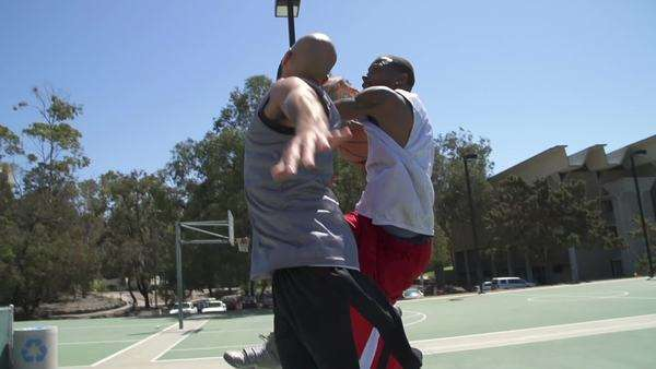 Two basketball players playing one on one outside. Royalty-free stock video