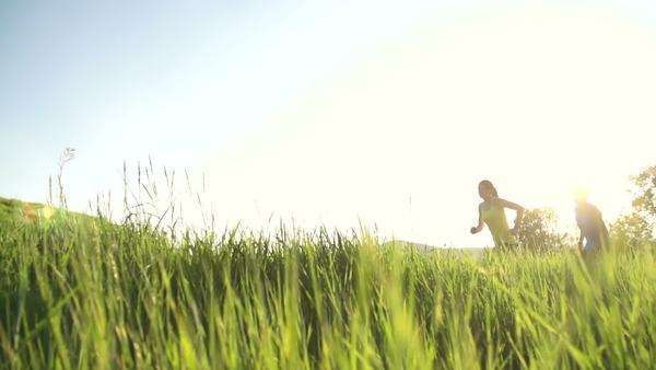 Couple running outside at sunset slow motion Royalty-free stock video