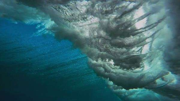 Underwater angle of tropical blue ocean wave breaking Royalty-free stock video