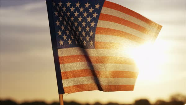 US car flag fluttering in the breeze at sunset, in slow motion Royalty-free stock video