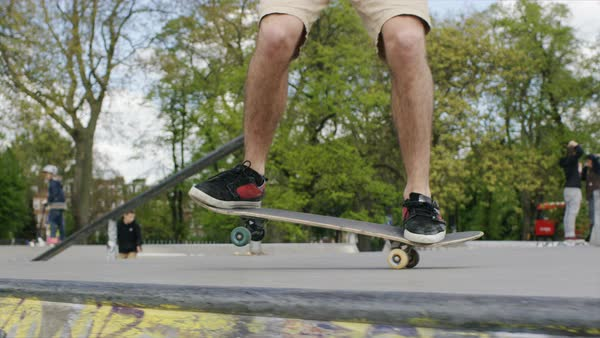 Skateboarder doing a nose manual trick falls over, in slow motion  Royalty-free stock video