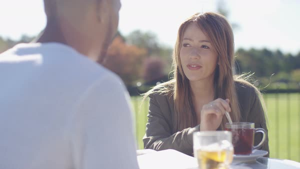 Young couple on a date having a conversation outdoors Royalty-free stock video