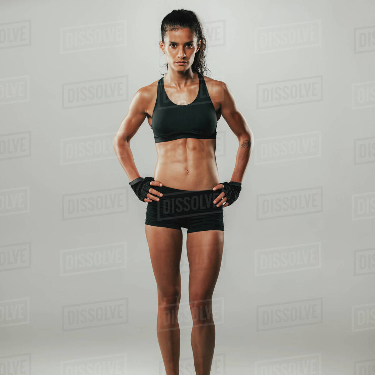 Fit Healthy Young Woman With A Strong Muscular Body Standing With Her Hands On Her Hips Looking Seriously At The Camera In Black Sportswear Stock Photo Dissolve Any posts or comments that don't follow. fit healthy young woman with a strong muscular body standing d2012 96 084