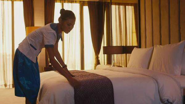 Hotel maid making up bed Royalty-free stock video