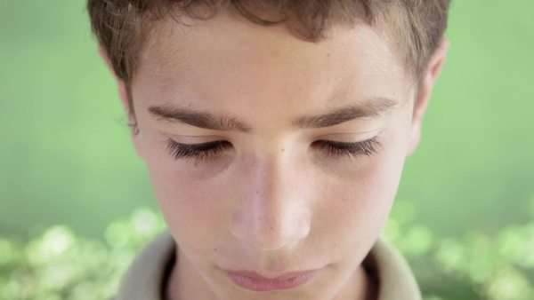 Young people and feelings, portrait of sad young hispanic boy looking at camera Royalty-free stock video