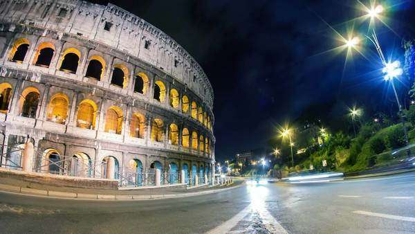 Coliseum night city traffic timelapse Royalty-free stock video