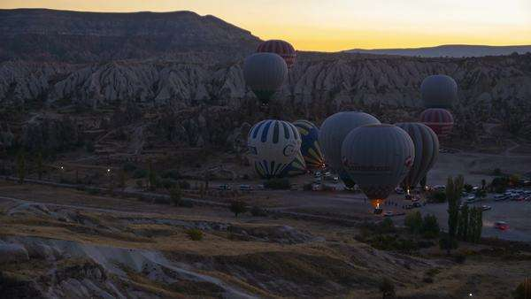 Motion timelapse of hot air balloons flying over valleys in Goreme, Cappadocia, Turkey Royalty-free stock video