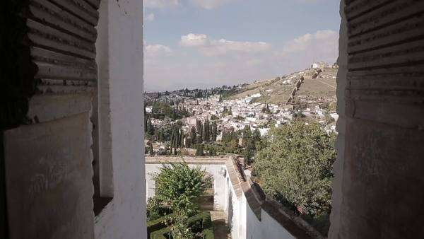 Peaking out a window of the Alhambra looking over the town in Granada, Spain Royalty-free stock video