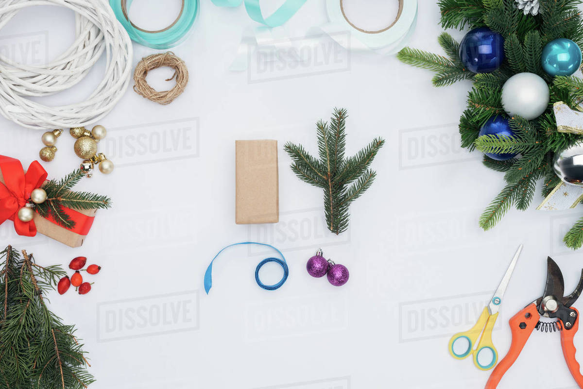 Christmas Top View.Top View Of Wrapped Christmas Gifts Pine Tree Branches And Decorations Isolated On White Stock Photo