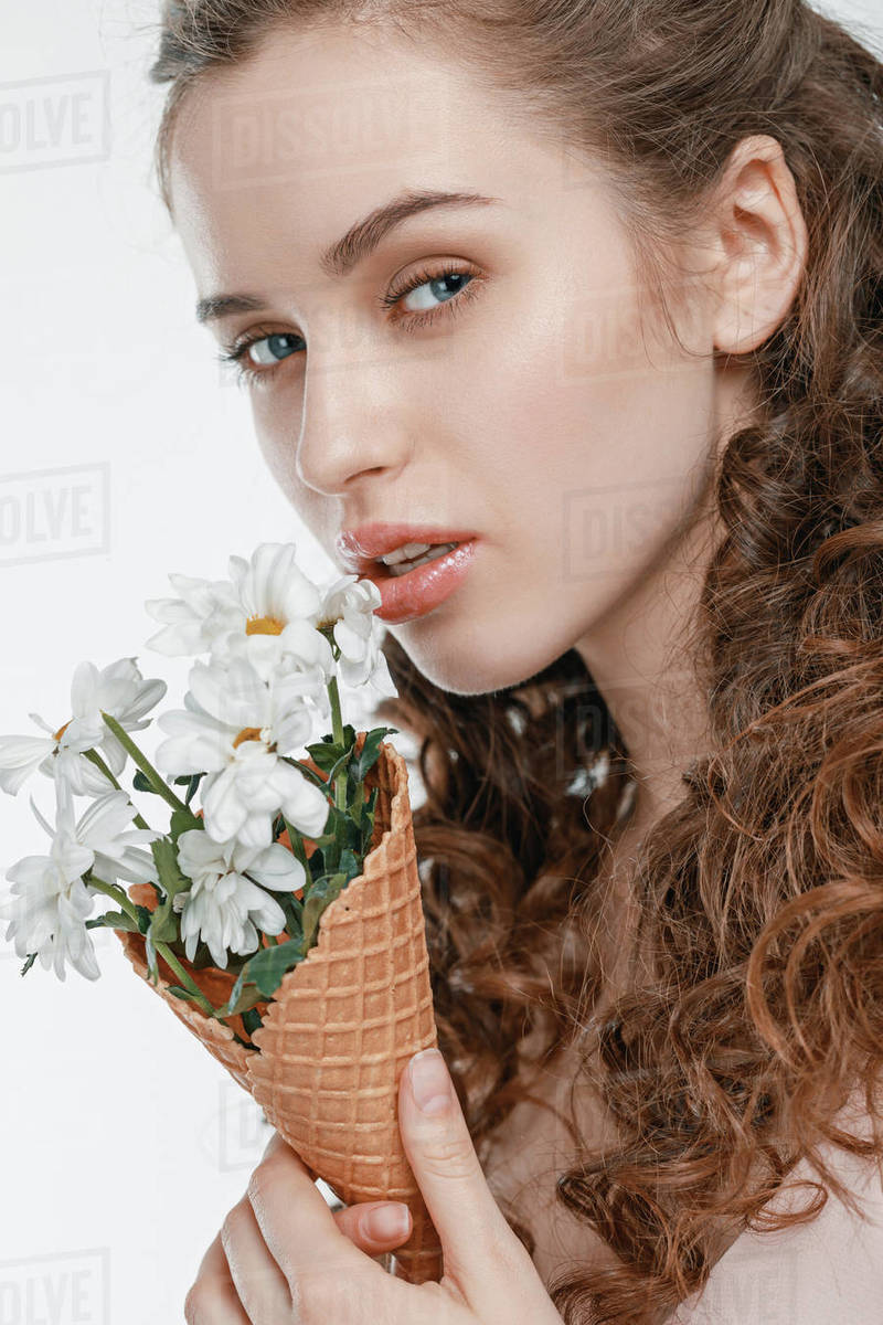 Portrait Of Attractive Young Woman With Spring Flowers Isolated On White Stock Photo