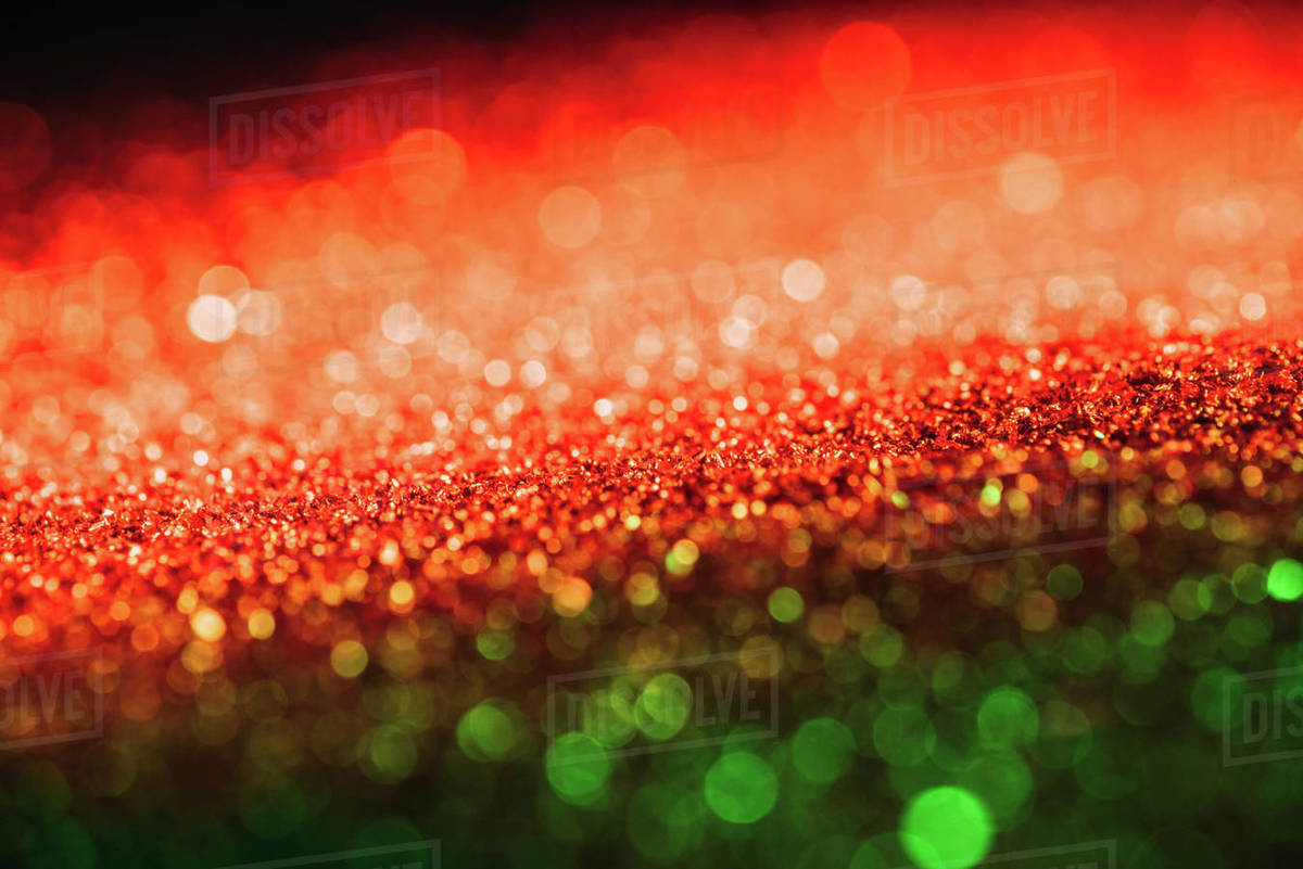 Christmas Texture.Glowing Christmas Texture With Red And Green Blurred Glitter Stock Photo