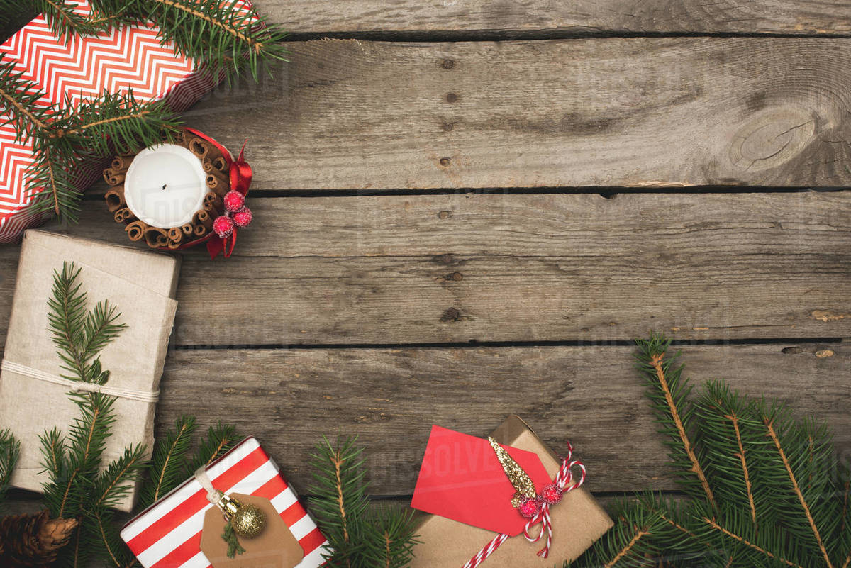 Christmas Top View.Top View Of Frame Of Christmas Gifts On Rustic Wooden Table Stock Photo