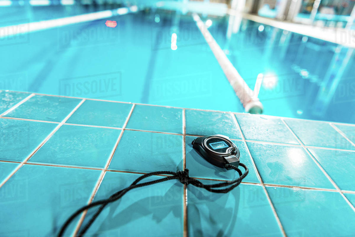 Timer lying at competition swimming pool stock photo