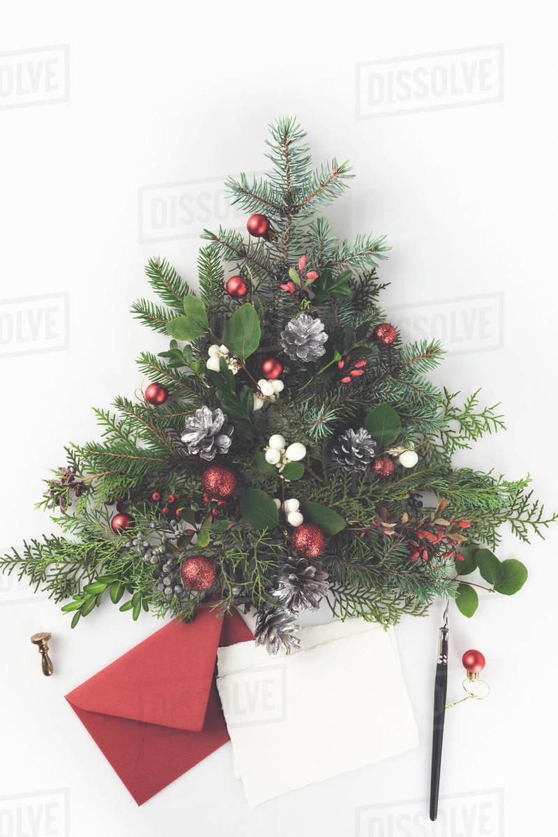 Christmas Tree Top View.Top View Of Christmas Tree Made Of Fir Branches Christmas Balls And Pine Cones With Letter And Pen Isolated On White Stock Photo