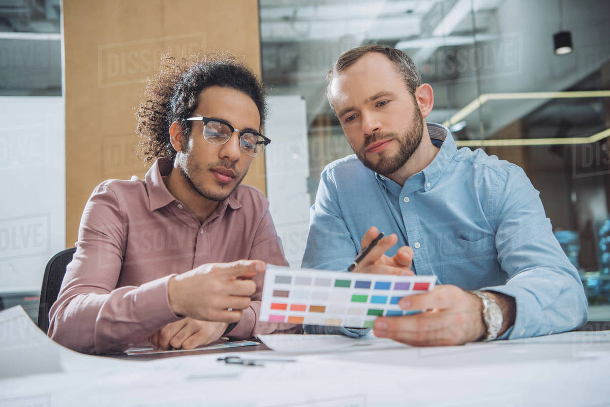 Designers choosing colors from palette for project at office Royalty-free stock photo