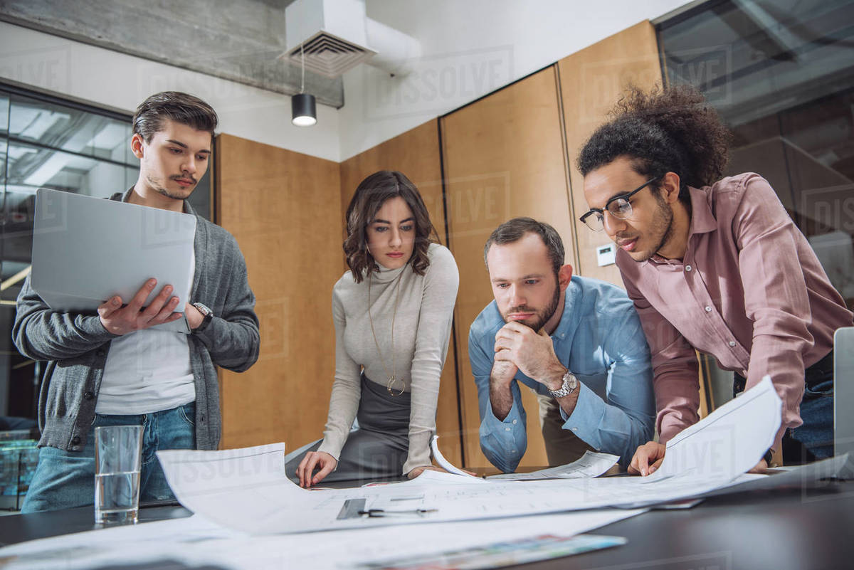 Group of thoughtful architects working together at office Royalty-free stock photo