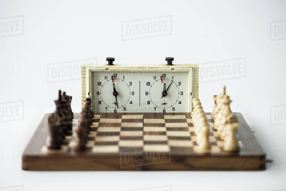 Chess Clock And Chess Board With Figures Set For New Game Isolated On White Stock Photo