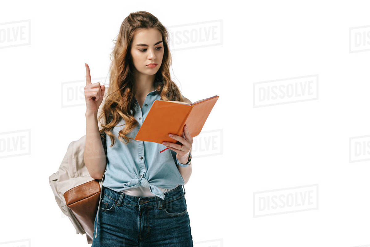 Beautiful Student Showing Idea Gesture And Reading Book Isolated On White Stock Photo