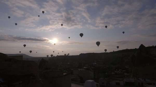 Wide shot showing hot-air ballons flying at sunset Royalty-free stock video