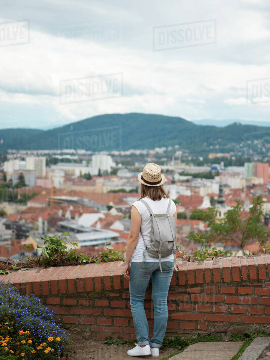 Back view of woman standing and looking at cityscape Royalty-free stock photo