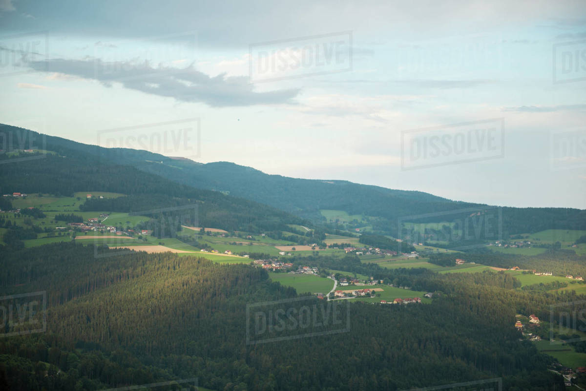 Aerial view of the village in forest surrounded by mountains Royalty-free stock photo