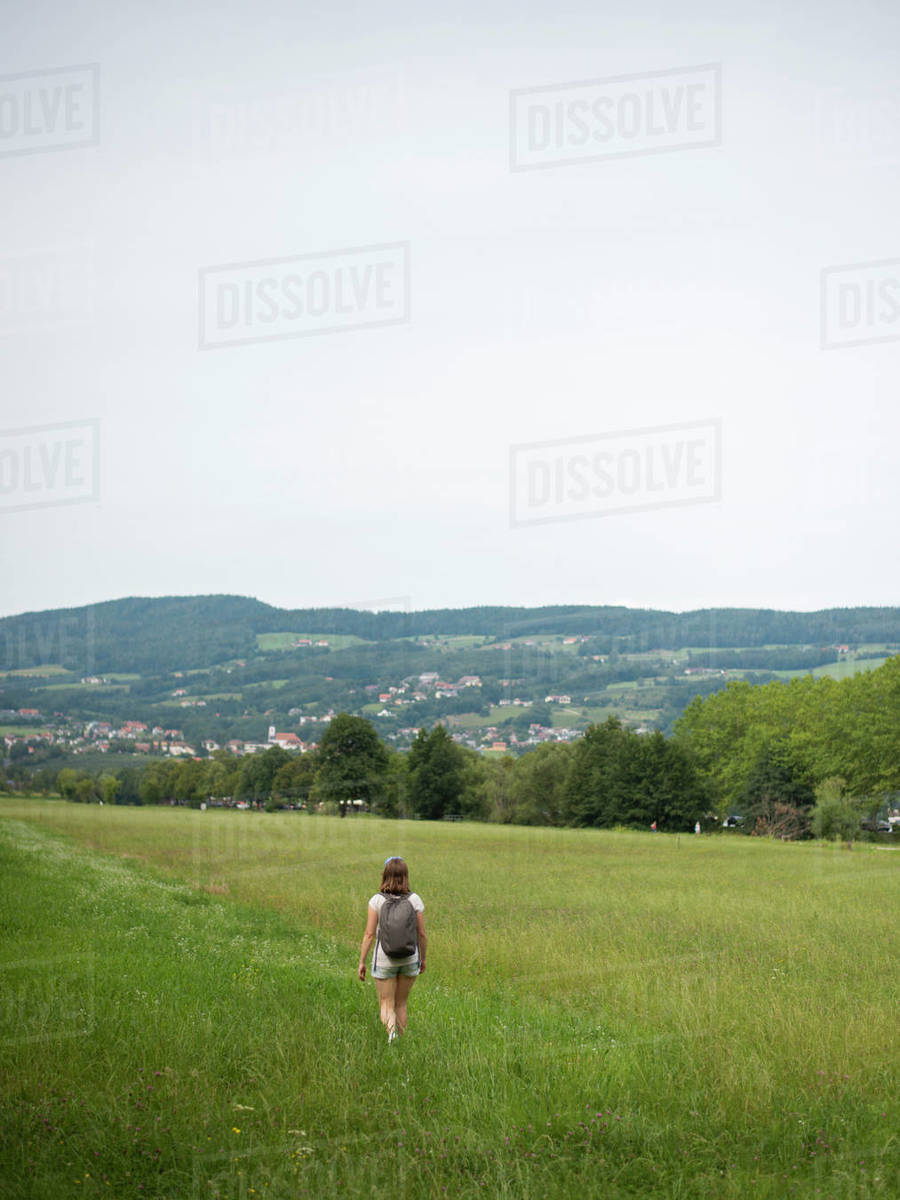 Woman walking in field during summer day Royalty-free stock photo