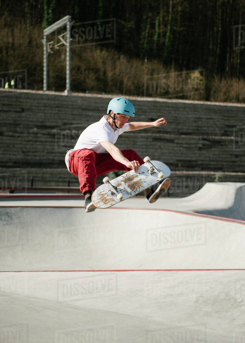 Young man performing mid-air trick on skateboard Royalty-free stock photo