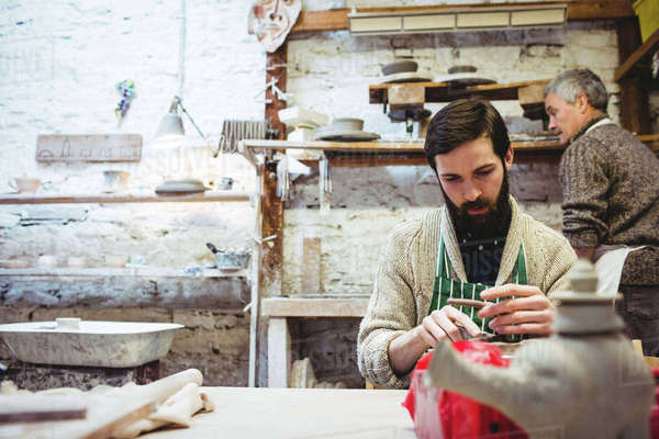 Male potters working in workshop Royalty-free stock photo