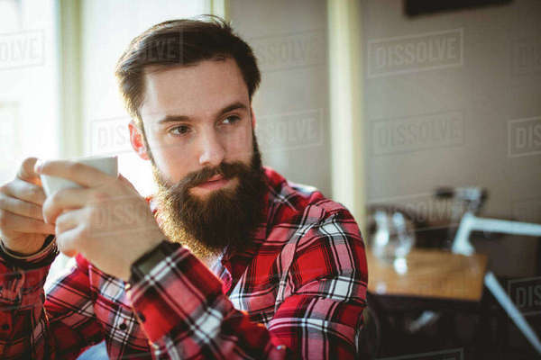 Thoughtful customer sitting with coffee at cafe Royalty-free stock photo