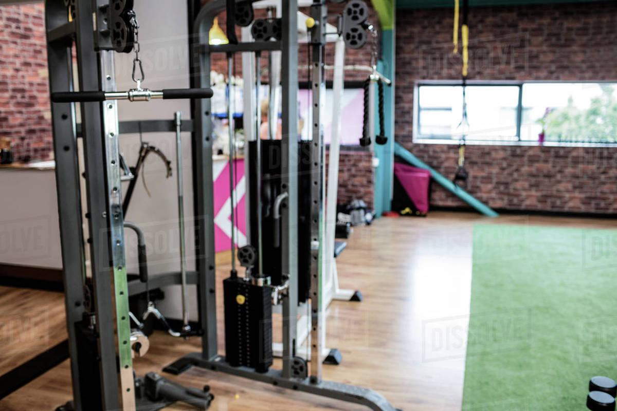 View of empty gym equipment in fitness studio stock photo dissolve