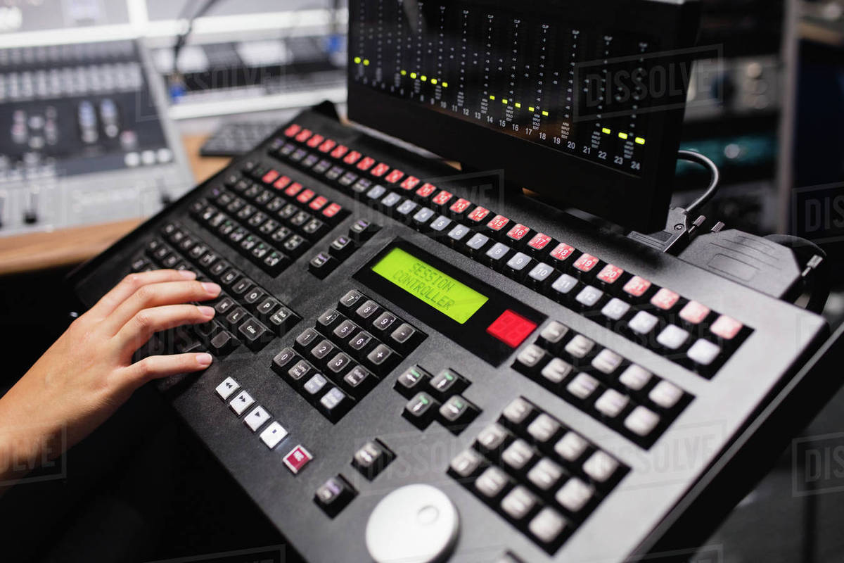 Hand of female student using sound mixer keyboard in a studio stock photo