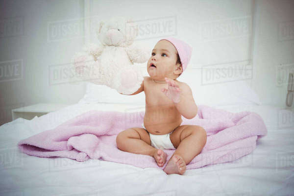 Cute baby girl on bed at home in bedroom Royalty-free stock photo