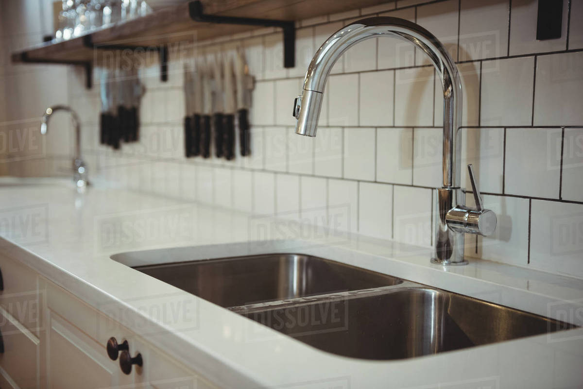 Close Up Of Chrome Sink And Faucet In Professional Kitchen