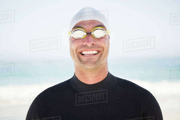 Portrait of smiling fit swimmer on the beach Royalty-free stock photo