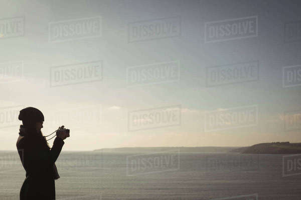 Woman taking photo on digital camera during day Royalty-free stock photo