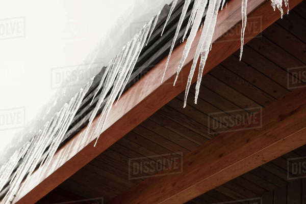 House covered with snow and icicles during winter Royalty-free stock photo