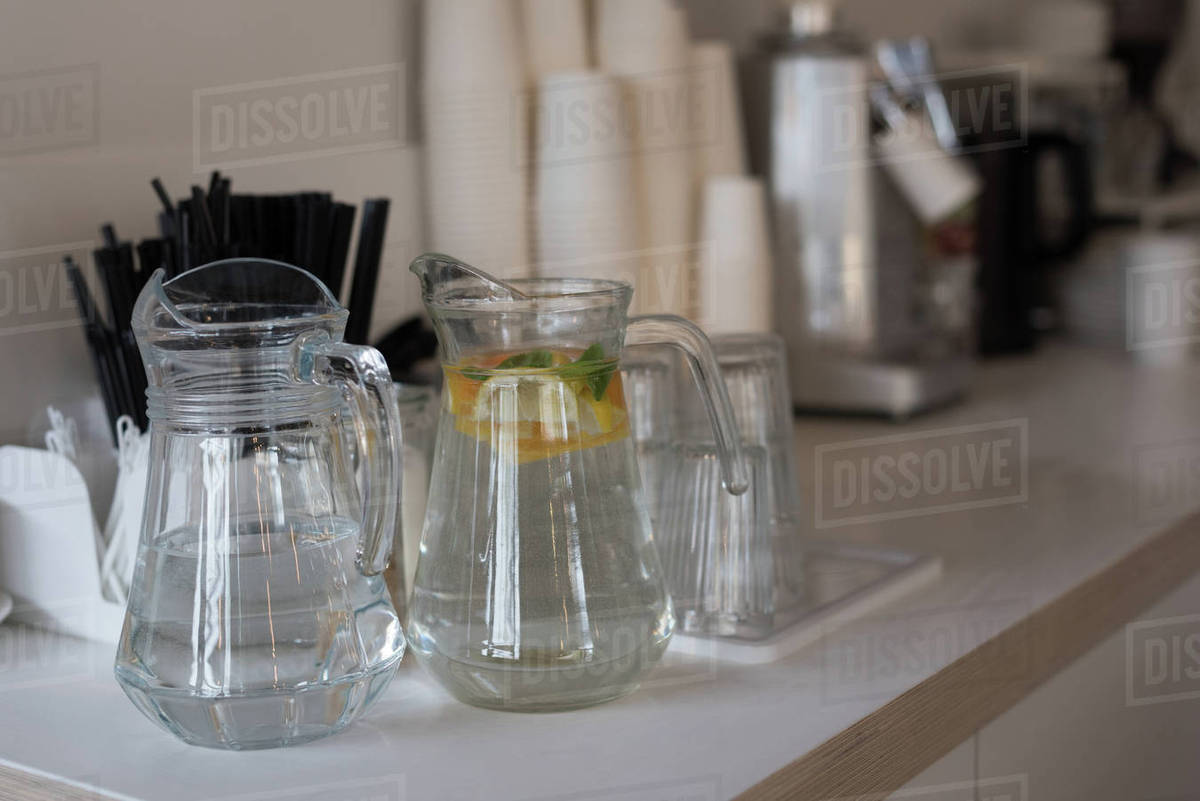 Close up of jars and drinking glasses on kitchen counter D23_54_378