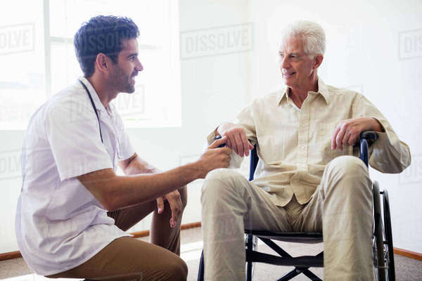 Nurse taking care of a senior man in a retirement home Royalty-free stock photo