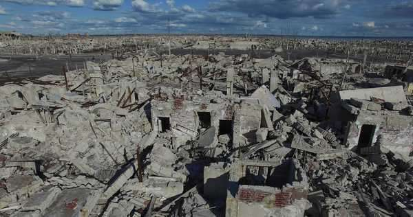Aerial drone scene of a city destroyed by natural disaster. Camera flys through the demolished city. Royalty-free stock video