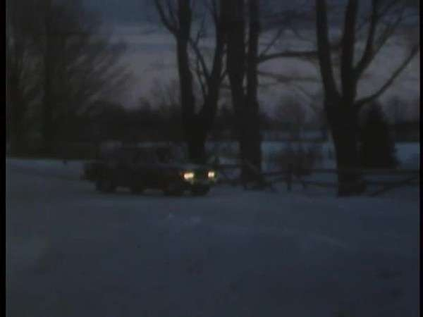 1950s Car Pulling Out Of Suburban Driveway At Night Stock Video
