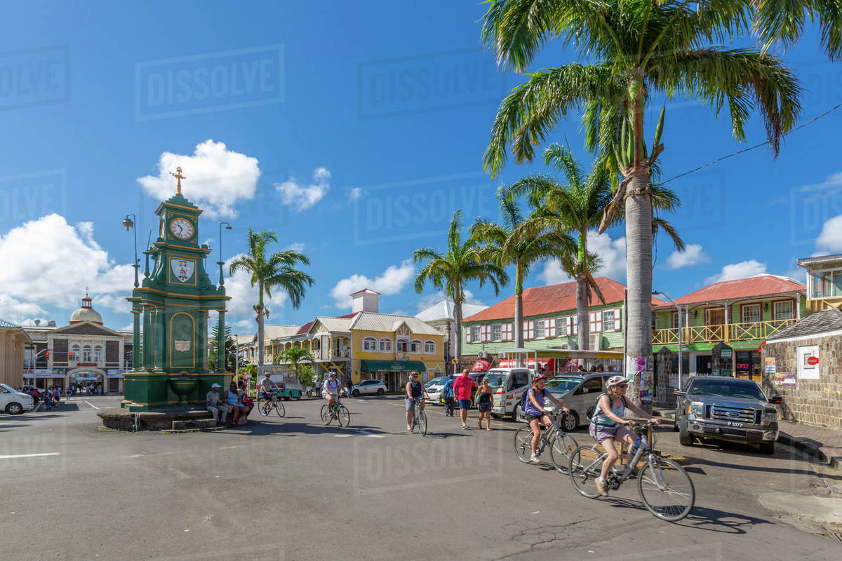 View of cyclists in The Circus and Memorial Clock, Basseterre, St. Kitts and Nevis, West Indies, Caribbean, Central America Royalty-free stock photo