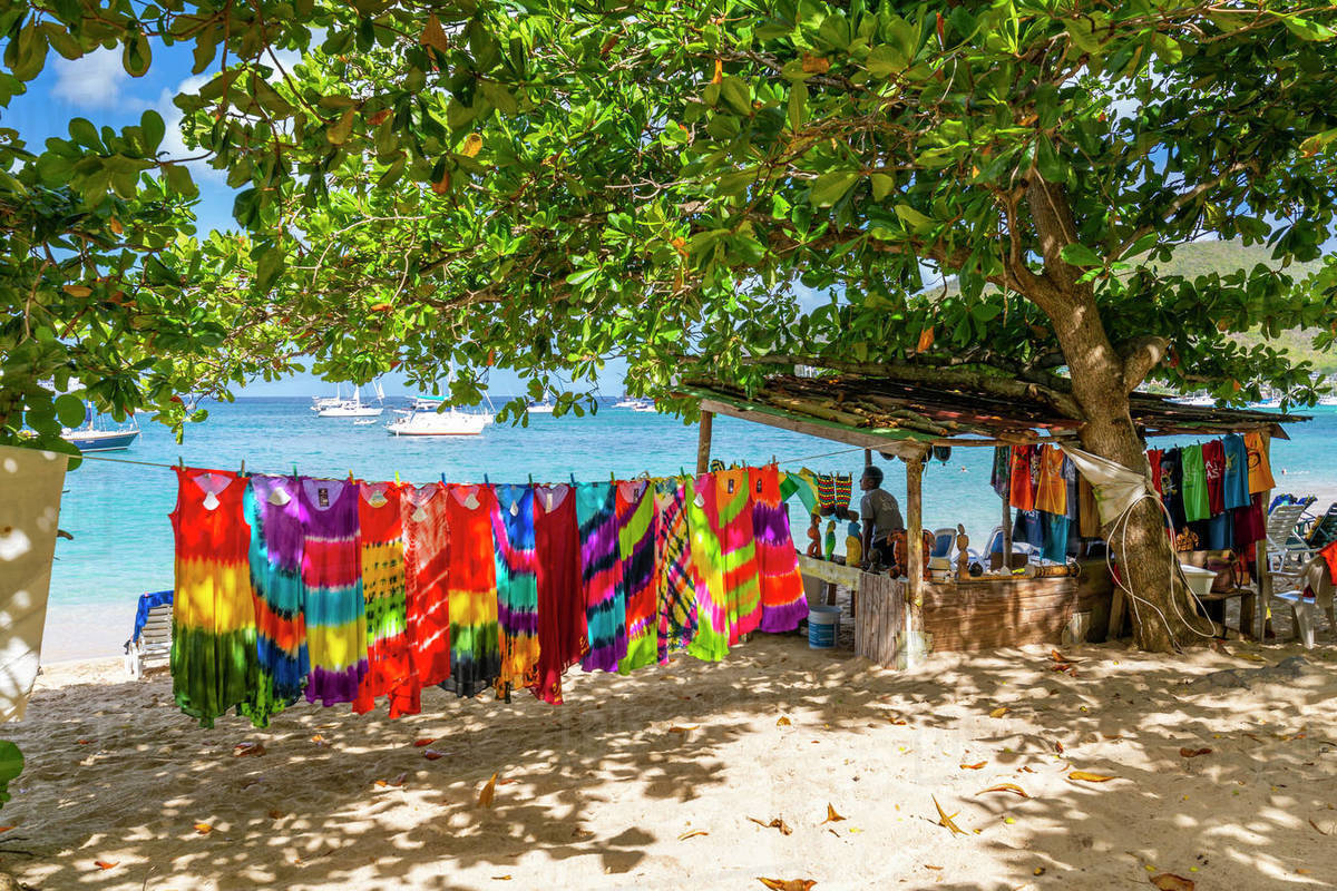 Colourful garments at Port Elizabeth, Admiralty Bay, Bequia, The Grenadines, St. Vincent and the Grenadines, Windward Islands, West Indies, Caribbean, Central America Royalty-free stock photo